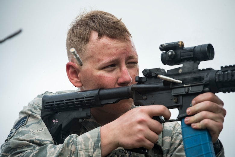 "Senior Airman Adam Irwin, 23rd Security Forces Squadron installation patrolman, expends extra rounds from an M4 carbine after a training event, Feb. 22, 2018, at Moody Air Force Base, Ga. ""Shoot, move, communicate"" is a training event that tests participants on their ability to move from barricade to barricade as a team. Security Forces members would employ these tactics anytime they're under enemy fire. (U.S. Air Force photo by Senior Airman Janiqua P. Robinson)"