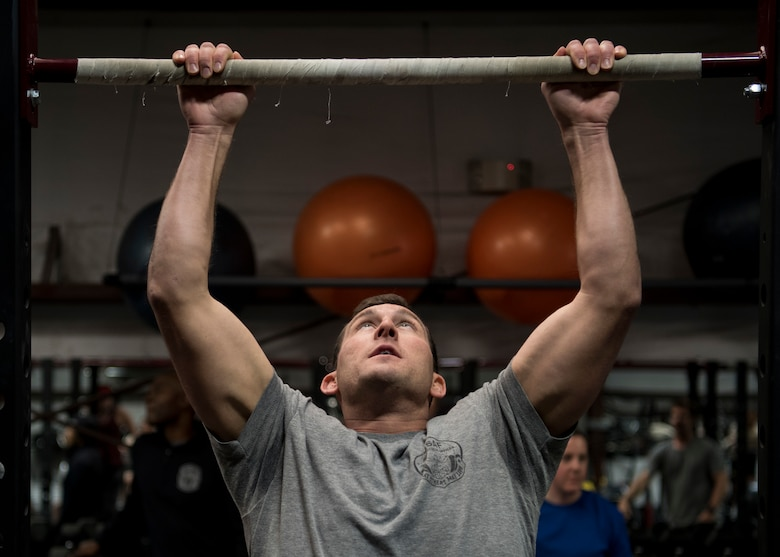 A participant in the Maltz Challenge performs a pull-up at Kirtland Air Force Base, N.M., March 9, 2018. More than 200 members of Kirtland AFB participated in the challenge. (U.S. Air Force photo by Staff Sgt. J.D. Strong II)