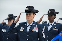 Chief Master Sgt. Hope L. Skibitsky, 737th Training Group and Air Force Basic Military Training superintendent, leads a female military training instructor mass during a BMT graduation March 9, 2018, at Joint Base San Antonio-Lackland, Texas. The formation was to honor National Women's History Month which Congress designated in March 1987. (U.S. Air Force photo by Ismael Ortega)