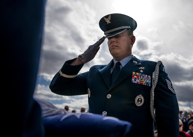 Tech. Sgt. John Shortell III salutes the flag of the late Lt. Col. Camilo Guerrero moments before it was presented to Guerrero's wife March 12, 2018, at the United States Air Force Academy, Colo. Guerrero served 21 years in the Air Force and passed away March 6, 2018, after a two-year battle with cancer. (U.S. Air Force photo by Tech. Sgt. David Salanitri)