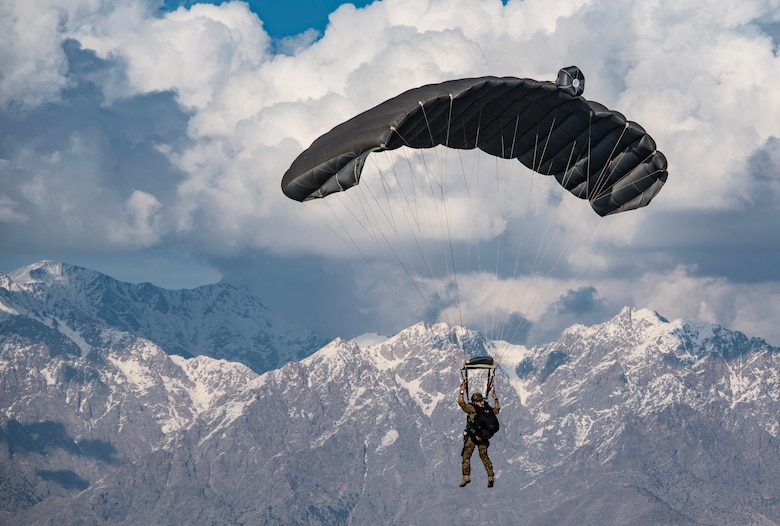 A  pararescueman assigned to the 83rd Expeditionary Rescue Squadron, Bagram Airfield, Afghanistan, operates the canopy of his parachute while conducting a high altitude, high opening military free fall jump working with a C-130J Super Hercules flown by the 774th Expeditionary Airlift Squadron, Bagram Airfield, Afghanistan, March 4, 2018. Guardian Angel Team members conduct training on all aspects of combat, medical procedures and search and rescue tactics to hone their skills, providing the highest level of tactical capabilities to combatant commanders. (U.S. Air Force courtesy photo by Tech. Sgt. Gregory Brook)