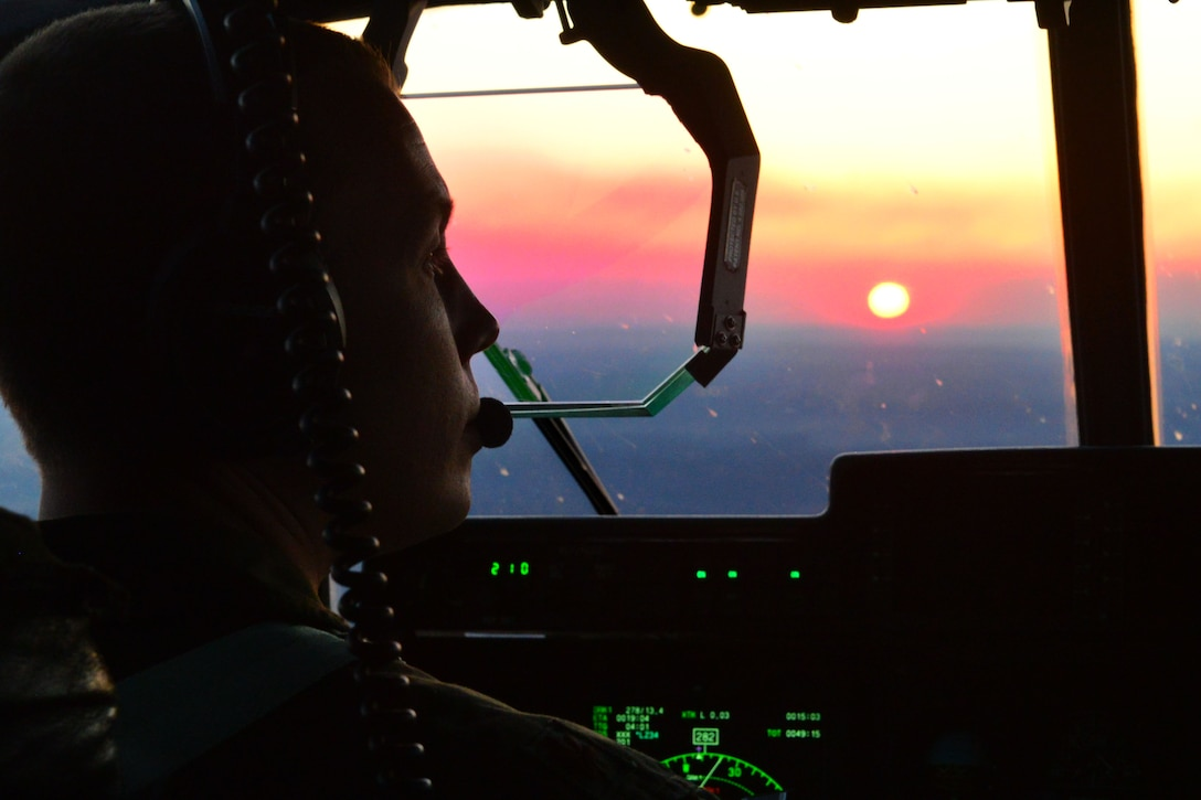 Maj. Christopher Boelscher, 61st Airlift Squadron pilot, operates a C-130J Mar. 13, 2018, near Little Rock Air Force Base, Ark. Team Little Rock hosted over 65 Airmen from six wings to train together and showcase tactical airlift. Partnerships and interoperability enhance operational effectiveness and mission readiness. (U.S. Air Force photo by Airman 1st Class Codie Collins)