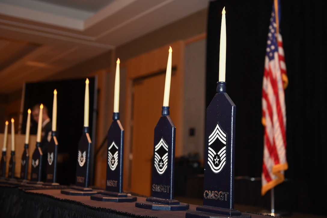 Nine candles representing the nine ranks of the enlisted Air Force stand center stage during the Hill Air Force Base Chief Master Sergeant Recognition Ceremony held March 10, 2018, at the Ogden Eccles Conference Center. (U.S. Air Force photo by Cynthia Griggs)