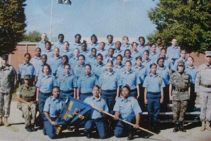 U.S. Army Reserve Sgt. Maribel Cano-Meraz, third row, right, then 17, pauses for a group photo with her group after graduating Lincoln's Challenge Academy, 2007.