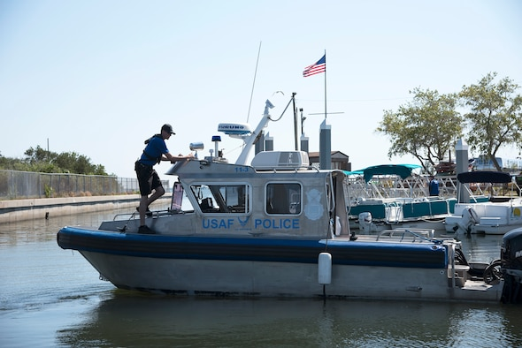 U.S. Air Force Marine Patrol crewmembers assigned to the 6th Security Forces Squadron, prepare to conduct a patrol of the waters around MacDill Air Force Base, Fla., March 5, 2018. Marine Patrol ensures the safety of the 7.2 mile coastline by running the perimeter 24 hours a day, seven days a week. (U.S. Air Force photo by Airman 1st Class Ashley Perdue)