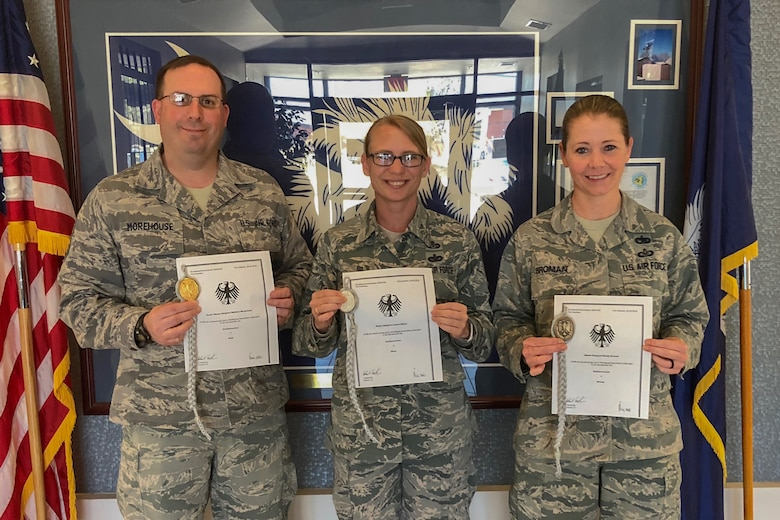 U.S. Air Force Senior Master Sgt. Matthew Morehouse, Master Sgt. Leeann Melton and Master Sgt. Wendy Broman, assigned to the South Carolina Air National Guard's 169th Fighter Wing, recieved the Schutzenschnur Badge for demonstrating profeciency in firing German weapons, March 7, 2018 at McEntire Joint National Guard Base, S.C. Several other service members were chosen to participate in a specialized training opportunity to work with German soldiers. They learned how to fire a German rifle, pistol and machine gun. (U.S. Air National Guard courtesy photo)