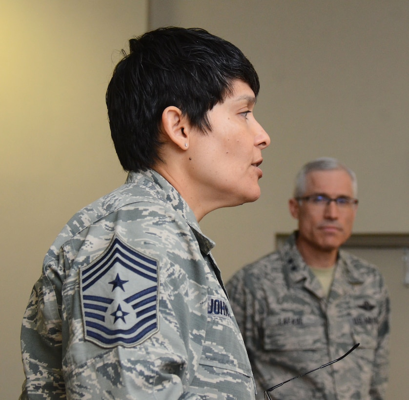 Twenty-Second Air Force Command Chief Imelda Johnson addresses the 22nd Air Force Senior Leader Summit attendees as 22nd Air Force Commander Maj. Gen. Craig La Fave looks on March 15, 2018 at Dobbins Air Reserve Base, Georgia.