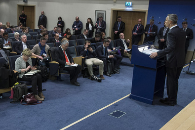NATO secretary general speaks at a lectern at NATO headquarters.