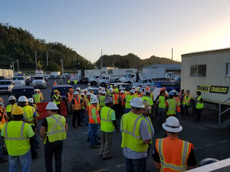 Contractors outside the Incident Support Base (ISB) at Ft. Buchanan receiving the morning assignments on 13 March 2018.