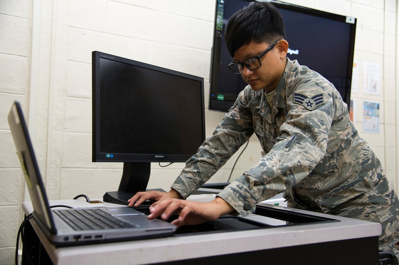 U.S. Air Force Senior Airman Jamie Matanane, a Reserve Citizen Airman with the 624th Regional Support Group Knowledge Operations Management alternate operating location in Guam, tests newly installed electronic components during a rebuild for an outdated testing station March 9, 2018, at Andersen Air Force Base, Guam. Five testing stations, which are used for individual Professional Military Education and career field upgrade testing, were rebuilt and restored to improve 624th RSG Test Control Office capabilities and sustainability for Reserve Citizen Airmen in Guam. (U.S. Air Force photo by Jerry R. Bynum)