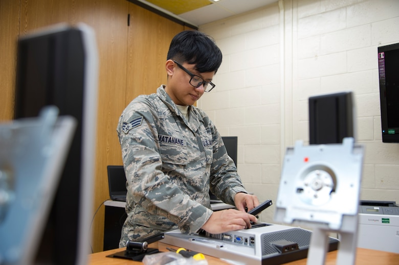 U.S. Air Force Senior Airman Jamie Matanane, a Reserve Citizen Airman with the 624th Regional Support Group Knowledge Operations Management alternate operating location in Guam, installs a computer monitor bracket as part of a rebuild for an outdated testing station March 9, 2018, at Andersen Air Force Base, Guam. Five testing stations, which are used for individual Professional Military Education and career field upgrade testing, were rebuilt and restored to improve 624th RSG Test Control Office capabilities and sustainability for Reserve Citizen Airmen in Guam. (U.S. Air Force photo by Jerry R. Bynum)