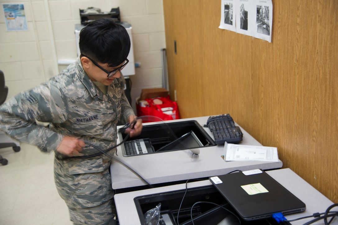 U.S. Air Force Senior Airman Jamie Matanane, a Reserve Citizen Airman with the 624th Regional Support Group Knowledge Operations Management alternate operating location in Guam, installs a new power supply as part of a rebuild for an outdated testing station March 9, 2018, at Andersen Air Force Base, Guam. Five testing stations, which are used for individual Professional Military Education and career field upgrade testing, were rebuilt and restored to improve 624th RSG Test Control Office capabilities and sustainability for Reserve Citizen Airmen in Guam. (U.S. Air Force photo by Jerry R. Bynum)