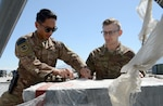 Staff Sgt. Josiah McDonald (left), 455th Expeditionary Logistic Readiness Squadron in-bound cargo NCOIC, and Senior Airman Michael Tomoiaga (right), 455th ELRS traffic management technician, inspect in-bound cargo Mar. 16, 2018 at Bagram Airfield, Afghanistan. Airmen from the 455th ELRS sort and distribute approximately 130 thousand pounds of cargo each month from multiple locations and organization. These shipments can range from camera equipment to aircraft parts. (U.S. Air Force photo/Staff Sgt. Divine Cox)