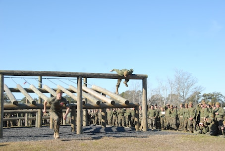 On March 15, 2018 Marine Corps Engineer School (MCES) hosted the annual St. Patrick's Day Engineer Field Meet to pay homage to St. Patrick, the patron saint for engineers; build camaraderie amongst the engineer and utility communities, and compete for the Engineer Field Meet Trophy. Teams of Marines compete in the Obstacle Course Relay to see who can run all their Marines through the Obstacle Course the fastest.