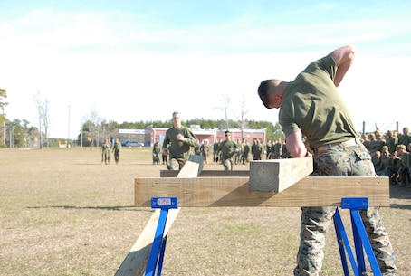 On March 15, 2018 Marine Corps Engineer School (MCES) hosted the annual St. Patrick's Day Engineer Field Meet to pay homage to St. Patrick, the patron saint for engineers; build camaraderie amongst the engineer and utility communities, and compete for the Engineer Field Meet Trophy. To complete a turn in the Cross Cut Relay, Marines sprint down Ellis Field to saw horses where they must use a crosscut saw to cut the end off of a piece of wood.