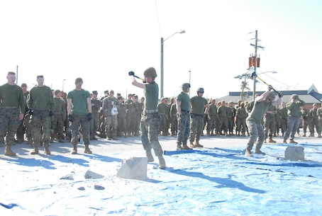 On March 15, 2018 Marine Corps Engineer School (MCES) hosted the annual St. Patrick's Day Engineer Field Meet to pay homage to St. Patrick, the patron saint for engineers; build camaraderie amongst the engineer and utility communities, and compete for the Engineer Field Meet Trophy.  Marines competing in the Find the Rebar Challenge use sledge hammers to break apart a cement block in order to find a piece of rebar.