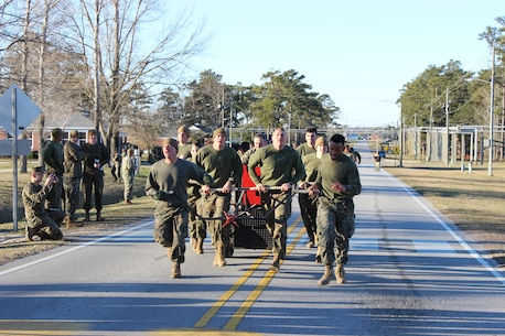 On March 15, 2018 Marine Corps Engineer School (MCES) hosted the annual St. Patrick's Day Engineer Field Meet to pay homage to St. Patrick, the patron saint for engineers; build camaraderie amongst the engineer and utility communities, and compete for the Engineer Field Meet Trophy.  This year there were five units that competed in Marine, engineer, and utility themed events:  MCES, Marine Wing Support Squadron-274 (MWSS-274), Combat Logistics Battalion-2 (CLB-2), 8th Engineer Support Battalion (8th ESB), and 2d Combat Engineer Battalion (2d CEB). Pictured is the MCES Chariot Race team.