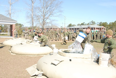 On March 15, 2018 Marine Corps Engineer School (MCES) hosted the annual St. Patrick's Day Engineer Field Meet to pay homage to St. Patrick, the patron saint for engineers; build camaraderie amongst the engineer and utility communities, and compete for the Engineer Field Meet Trophy. Marines competing in the Water Bucket Relay sprinted across Ellis Field with empty buckets to water bladders, filled the buckets, and then sprinted back across Ellis Field in order to be the first team to fill a 55-gallon trash can.