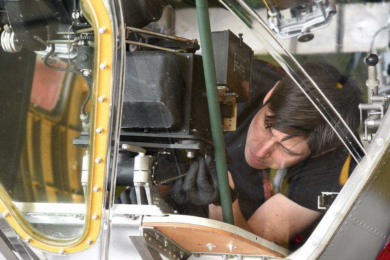 (03/09/2018) -- Museum restoration specialist Casey Simmons installs a bomb sight in the Boeing B-17F Memphis Belle. Plans call for the aircraft to be placed on permanent public display in the WWII Gallery here at the National Museum of the U.S. Air Force on May 17, 2018. (U.S. Air Force photo by Ken LaRock)