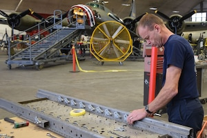 (02/22/2018) -- Museum restoration specialist Brian Lindamood works on the bomb racks of the Boeing B-17F Memphis Belle. Plans call for the aircraft to be placed on permanent public display in the WWII Gallery here at the National Museum of the U.S. Air Force on May 17, 2018. (U.S. Air Force photo by Ken LaRock)