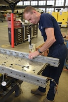 (02/22/2018) -- Museum restoration specialist Brian Lindamood works on the bomb racks for the Boeing B-17F Memphis Belle. Plans call for the aircraft to be placed on permanent public display in the WWII Gallery here at the National Museum of the U.S. Air Force on May 17, 2018. (U.S. Air Force photo by Ken LaRock)