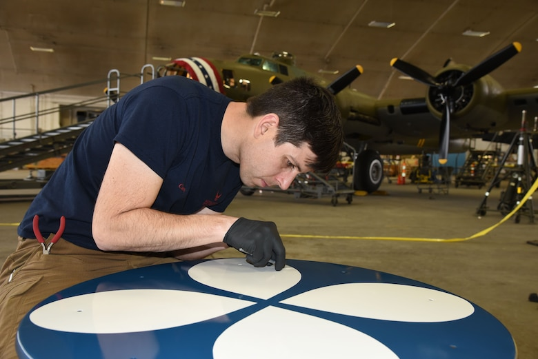 (02/22/2018) -- Museum restoration specialist Casey Simmons paints the wheel covers for the Boeing B-17F Memphis Belle. Plans call for the aircraft to be placed on permanent public display in the WWII Gallery here at the National Museum of the U.S. Air Force on May 17, 2018. (U.S. Air Force photo by Ken LaRock)
