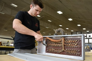 (02/22/2018) -- Museum restoration specialist Jason Davis works on bomb bay components for the Boeing B-17F Memphis Belle. Plans call for the aircraft to be placed on permanent public display in the WWII Gallery here at the National Museum of the U.S. Air Force on May 17, 2018. (U.S. Air Force photo by Ken LaRock)