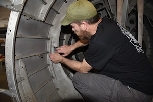 (02/26/2018) -- Museum restoration specialist Chad Vanhook attaches a data plate to the Boeing B-17F Memphis Belle. Plans call for the aircraft to be placed on permanent public display in the WWII Gallery here at the National Museum of the U.S. Air Force on May 17, 2018. (U.S. Air Force photo by Ken LaRock)