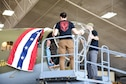 (02/26/2018) -- Museum restoration specialists Casey Simmons, Roger Brigner and Chad Vanhook attach the nose cone onto the Boeing B-17F Memphis Belle. Plans call for the aircraft to be placed on permanent public display in the WWII Gallery here at the National Museum of the U.S. Air Force on May 17, 2018. (U.S. Air Force photo by Ken LaRock)