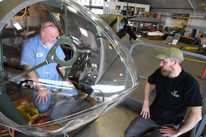 (02/26/2018) -- Museum restoration specialists Roger Brigner and Chad Vanhook work on the bomb sight mount in the Boeing B-17F Memphis Belle. Plans call for the aircraft to be placed on permanent public display in the WWII Gallery here at the National Museum of the U.S. Air Force on May 17, 2018. (U.S. Air Force photo by Ken LaRock)