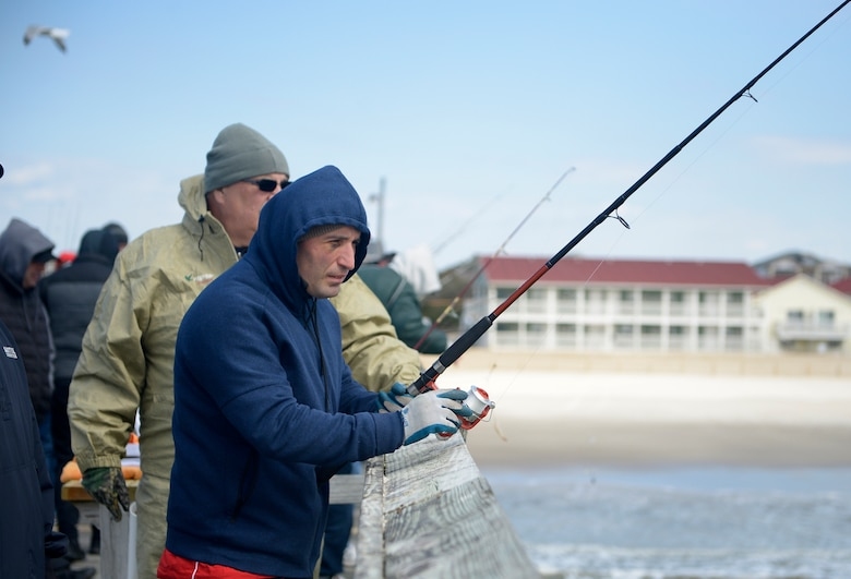 "Georgia Army civilian staff member, Zurab Chachanidze, a member of the 2018 Marine Corps Trials Georgian team looks out at the ocean while fishing at Ocean Crest Pier in Oak Island, N.C., March 14, 2018, as part of the USO of North Carolina's ""American Experience Day."" The Marine Corps Trials promotes recovery and rehabilitation through adaptive sport participation and develops camaraderie among recovering service members and veterans. It is as an opportunity for RSMs to demonstrate their achievements and serves as the primary venue to select Marine Corps participants for the DoD Warrior Games."