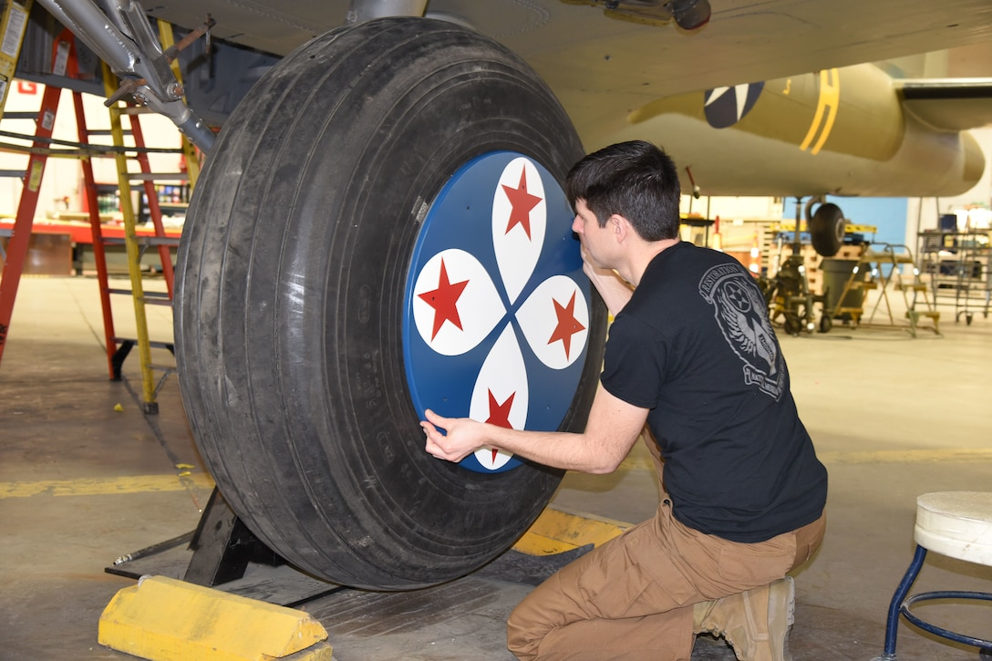 (03/01/2018) -- Museum restoration specialist Casey Simmons test fits the wheel covers on the Boeing B-17F Memphis Belle. Plans call for the aircraft to be placed on permanent public display in the WWII Gallery here at the National Museum of the U.S. Air Force on May 17, 2018. (U.S. Air Force photo by Ken LaRock)