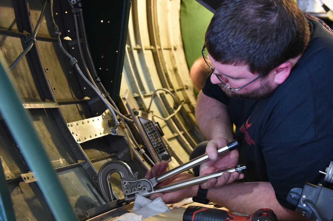 (03/01/2018) -- Museum restoration specialist Jeremy Gallogly works in the nose of the Boeing B-17F Memphis Belle. Plans call for the aircraft to be placed on permanent public display in the WWII Gallery here at the National Museum of the U.S. Air Force on May 17, 2018. (U.S. Air Force photo by Ken LaRock)