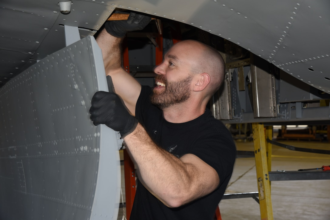 (03/06/2018) -- Museum restoration specialist Chase Meredith attaches bomb bay doors of the Boeing B-17F Memphis Belle. Plans call for the aircraft to be placed on permanent public display in the WWII Gallery here at the National Museum of the U.S. Air Force on May 17, 2018. (U.S. Air Force photo by Ken LaRock)