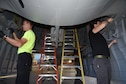 (03/06/2018) -- Museum restoration crews attach bomb bay doors of the Boeing B-17F Memphis Belle. Plans call for the aircraft to be placed on permanent public display in the WWII Gallery here at the National Museum of the U.S. Air Force on May 17, 2018. (U.S. Air Force photo by Ken LaRock)