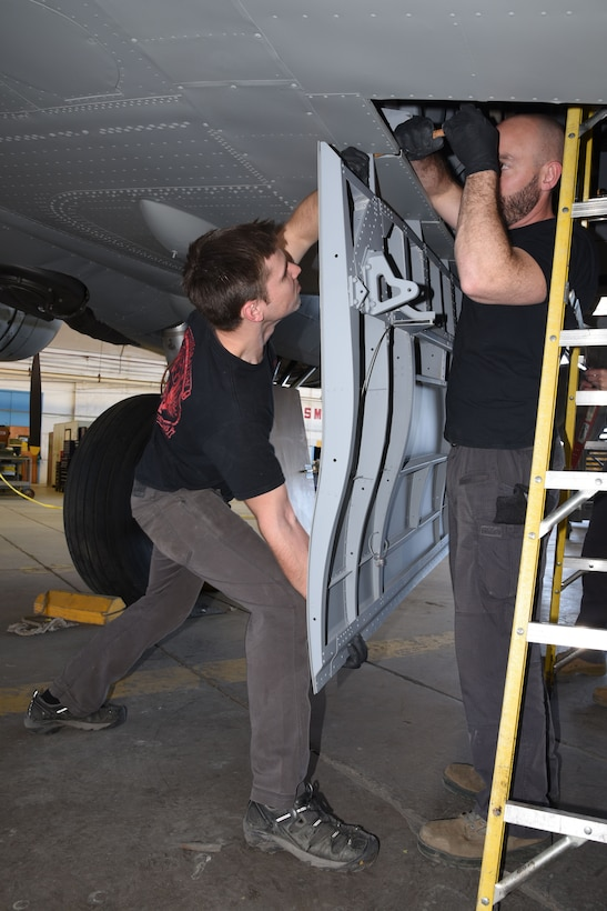 (03/06/2018) -- Museum restoration specialists Jason Davis and Chase Meredith attach bomb bay doors of the Boeing B-17F Memphis Belle. Plans call for the aircraft to be placed on permanent public display in the WWII Gallery here at the National Museum of the U.S. Air Force on May 17, 2018. (U.S. Air Force photo by Ken LaRock)