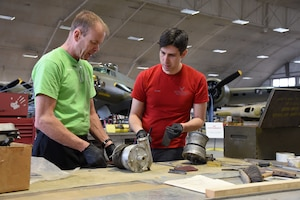 (03/07/2018) -- Museum restoration specialists Brian Lindamood and Casey Simmons working on bomb bay parts for the Boeing B-17F Memphis Belle. Plans call for the aircraft to be placed on permanent public display in the WWII Gallery here at the National Museum of the U.S. Air Force on May 17, 2018. (U.S. Air Force photo by Ken LaRock)