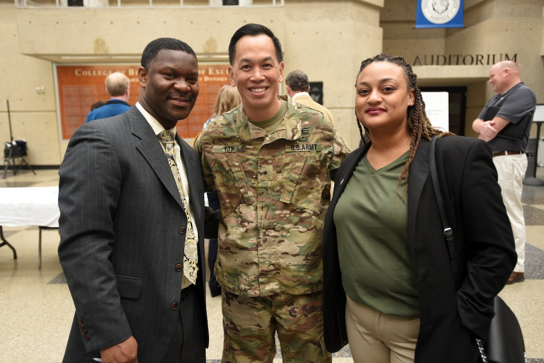 "Brig. Gen. Mark Toy, U.S. Army Corps of Engineers Great Lakes and Ohio River Division commander, meets with Christopher Ballard, vice president of operations for Simms Building Group, and Endia Javon, administrative assistant and project administrator for Simms Building Group, during the Business Opportunities Open House, also known as ""BOOH,"" at Tennessee State University in Nashville, Tenn., March 15, 2018. (USACE photo by Lee Roberts)"