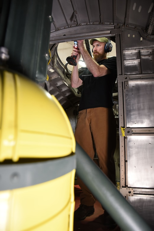 (03/07/2018) -- Museum restoration specialist Chad Vanhook works in the radio room of the Boeing B-17F Memphis Belle. Plans call for the aircraft to be placed on permanent public display in the WWII Gallery here at the National Museum of the U.S. Air Force on May 17, 2018. (U.S. Air Force photo by Ken LaRock)