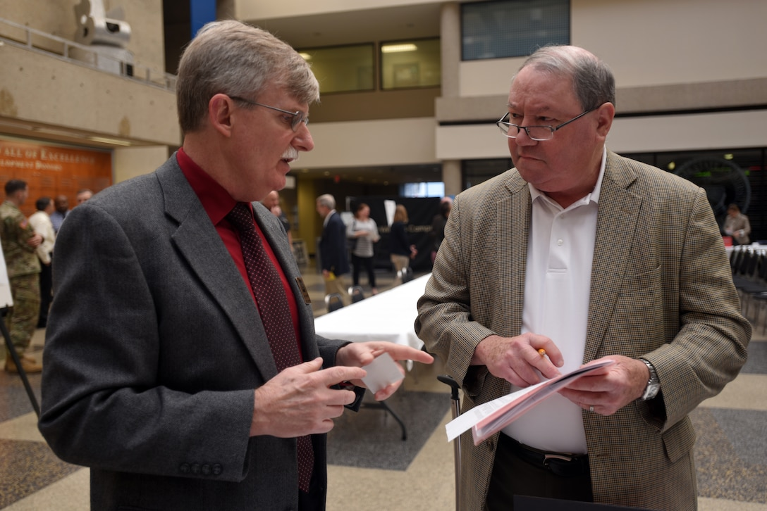 """Jamie James (Left), U.S. Army Corps of Engineers Nashville District Section 212 Hydropower Rehabilitation Program manager, provides information to Jack Heaten, Andritz Hydro Business Development director, during the Business Opportunities Open House, also known as """"BOOH,"""" at Tennessee State University in Nashville, Tenn., March 15, 2018. (USACE photo by Lee Roberts)"""