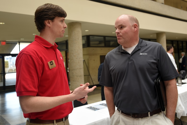 "Christopher Stoltz (Left), U.S. Army Corps of Engineers Nashville District environmental engineer, interacts with Adam Crace, project manager with Stantec, during the Business Opportunities Open House, also known as ""BOOH,"" at Tennessee State University in Nashville, Tenn., March 15, 2018. (USACE photo by Lee Roberts)"