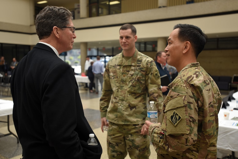 "Brig. Gen. Mark Toy (Right), U.S. Army Corps of Engineers Great Lakes and Ohio River Division commander, and Maj. Justin Toole, Nashville District acting commander, speak with Marc J. Norris, Pro2Serve vice president and Business Development director, during the Business Opportunities Open House, also known as ""BOOH,"" at Tennessee State University in Nashville, Tenn., March 15, 2018. (USACE photo by Lee Roberts)"