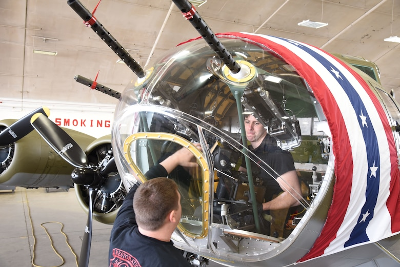 (03/09/2018) -- Museum restoration specialists Nick Almeter and Casey Simmons install a bomb sight in the Boeing B-17F Memphis Belle. Plans call for the aircraft to be placed on permanent public display in the WWII Gallery here at the National Museum of the U.S. Air Force on May 17, 2018. (U.S. Air Force photo by Ken LaRock)