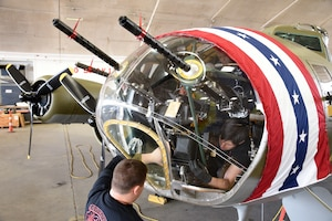 (01/30/2018) -- Museum restoration specialists Nick Almeter and Casey Simmons install a bomb sight in the Boeing B-17F Memphis Belle. Plans call for the aircraft to be placed on permanent public display in the WWII Gallery here at the National Museum of the U.S. Air Force on May 17, 2018. (U.S. Air Force photo by Ken LaRock)