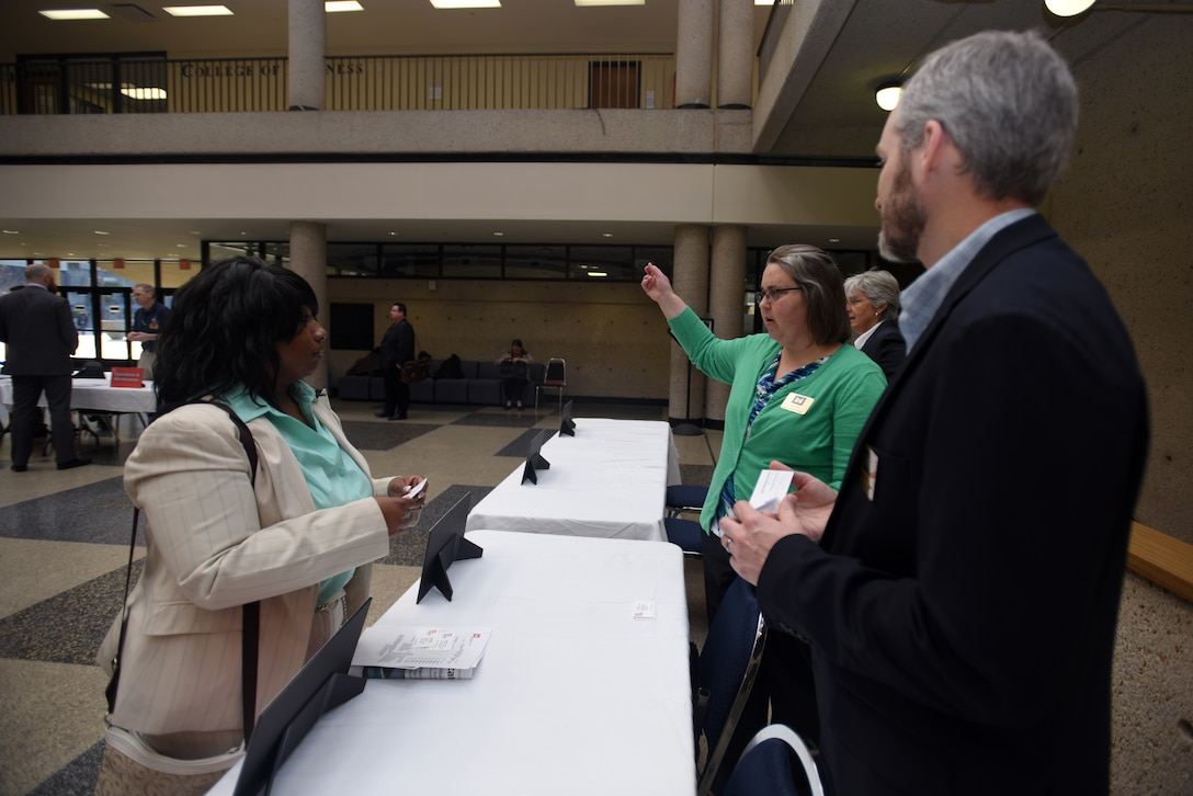 """Angela Dunn (Middle), U.S. Army Corps of Engineers Nashville District Planning Branch chief and Adam Walker, Chickamauga Lock Replacement Project manager, provide information to Nanette Brooks, owner of Lean Solutions, during the Business Opportunities Open House, also known as """"BOOH,"""" at Tennessee State University in Nashville, Tenn., March 15, 2018. (USACE photo by Lee Roberts)"""