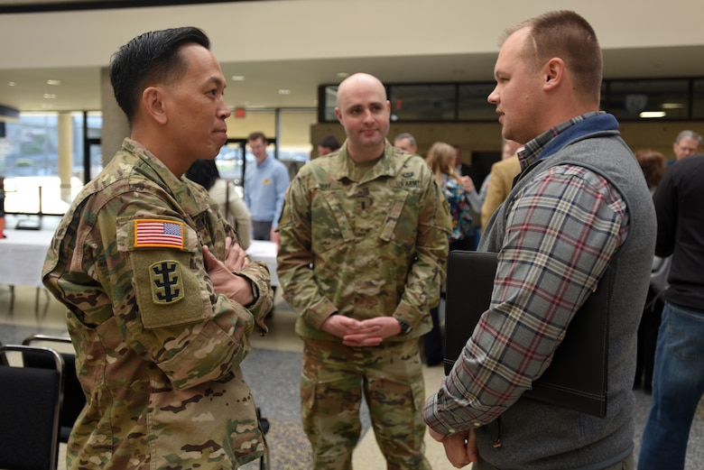 "Brig. Gen. Mark Toy (Left), U.S. Army Corps of Engineers Great Lakes and Ohio River Division commander, and 1st Lt. Trey Huff, aide-de-camp, speak with Garrett Dean, project manager with American Engineers, Inc., during the Business Opportunities Open House, also known as ""BOOH,"" at Tennessee State University in Nashville, Tenn., March 15, 2018. (USACE photo by Lee Roberts)"
