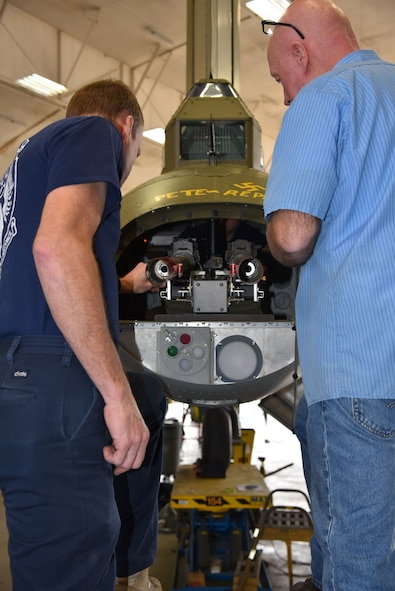 (01/30/2018) --  Museum restoration specialists Roger Brigner and Brian Lindamood install the tail guns for the Boeing B-17F Memphis Belle. Plans call for the aircraft to be placed on permanent public display in the WWII Gallery here at the National Museum of the U.S. Air Force on May 17, 2018. (U.S. Air Force photo by Ken LaRock)