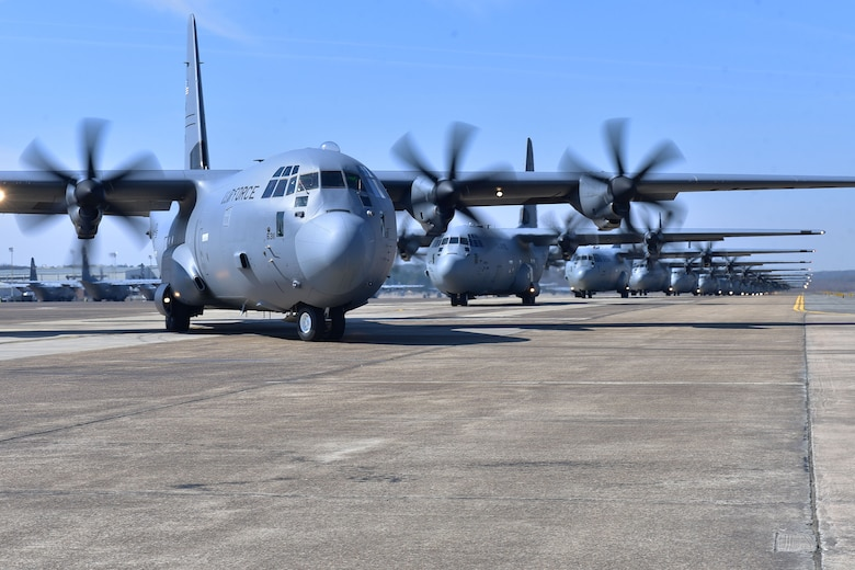 Nineteen C-130s taxi and prepare for takeoff.