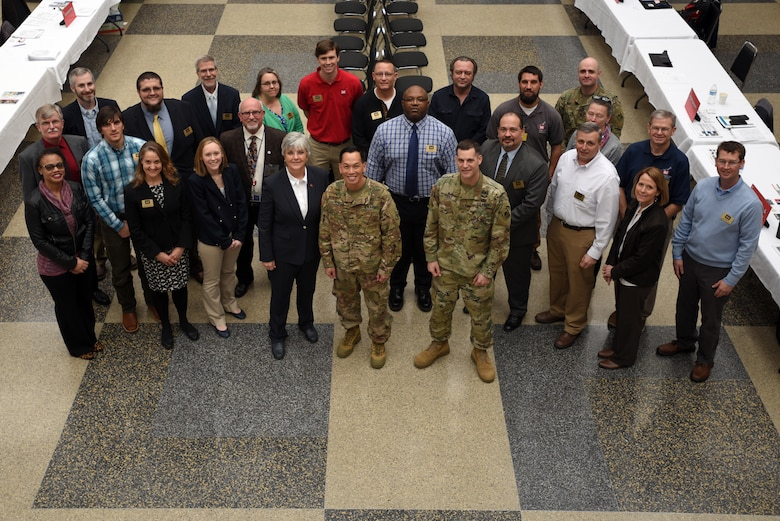 "Brig. Gen. Mark Toy, U.S. Army Corps of Engineers Great Lakes and Ohio River Division commander, joins Maj. Justin Toole, Nashville District acting commander, in a group photo with Corps employees who participated in the Business Opportunities Open House, also known as ""BOOH,"" at Tennessee State University in Nashville, Tenn., March 15, 2018. (USACE photo by Lee Roberts)"