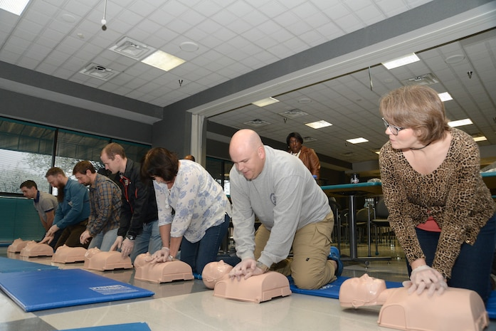Employees of the U.S. Army Engineering and Support Center, Huntsville, practice chest compressions on medical dummies during a first aid and CPR training and certification session March 1 at the Center. Along with their primary duties, the employees serve as first aid attendants for Huntsville Center and must certify annually.
